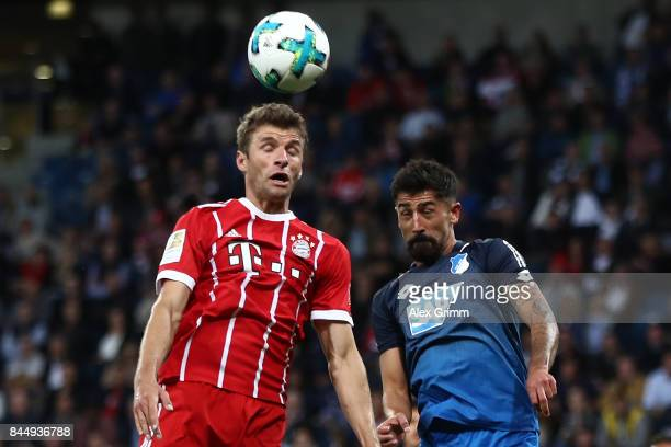 Thomas Mueller of Bayern Muenchen fights for the ball with Kerem Demirbay of Hoffenheim during the Bundesliga match between TSG 1899 Hoffenheim and...
