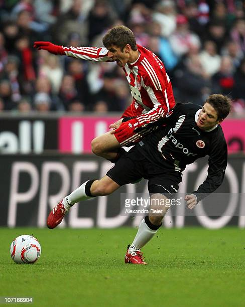 Thomas Mueller of Bayern Muenchen fights for the ball with Pirmin Schwegler of Frankfurt during the Bundesliga match between FC Bayern Muenchen and...