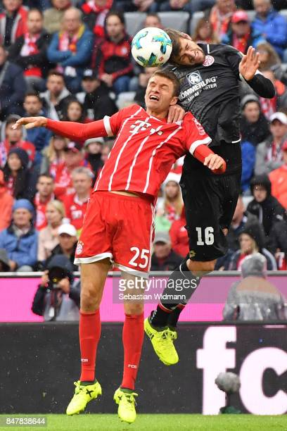 Thomas Mueller of Bayern Muenchen fights for the ball with Stefan Bell of Mainz during the Bundesliga match between FC Bayern Muenchen and 1 FSV...