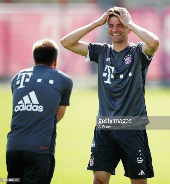 Thomas Mueller of Bayern Muenchen has a laugh with Philipp Lahm during training at Saebener Strasse training ground on March 30 2017 in Munich Germany