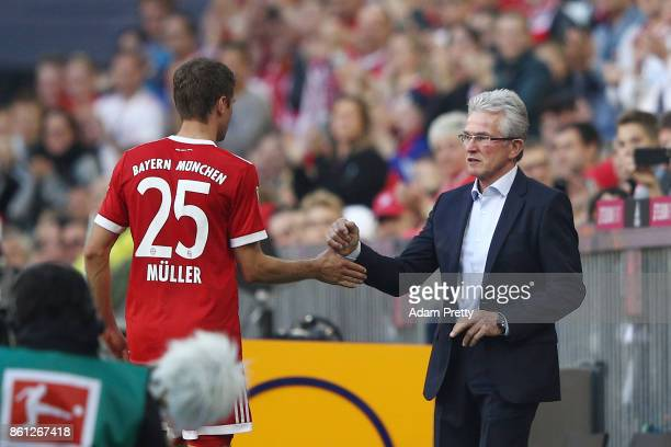 Thomas Mueller of Bayern Muenchen is sbstituted and shakes hands with coach Jupp Heynckes during the Bundesliga match between FC Bayern Muenchen and...