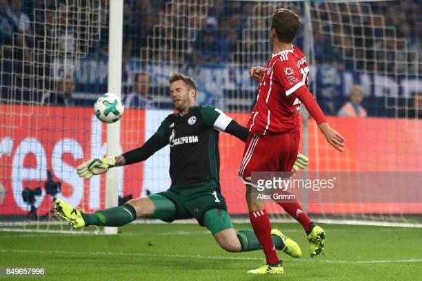 Thomas Mueller of Bayern Muenchen misses a chance against goalkeeper Ralf Faehrmann of Schalke during the Bundesliga match between FC Schalke 04 and...