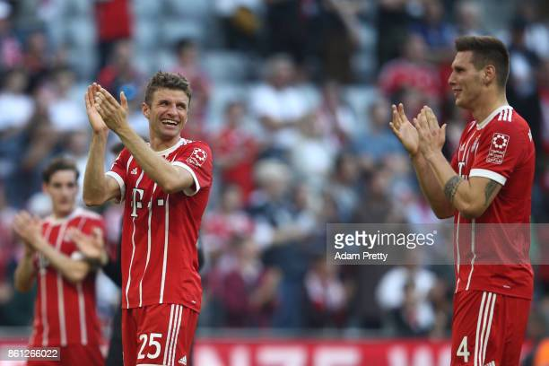 Thomas Mueller of Bayern Muenchen Niklas Suele of Bayern Muenchen celebrate after the Bundesliga match between FC Bayern Muenchen and SportClub...