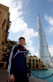 Thomas Mueller of Bayern Muenchen poses for a photo in front of the Burj Dubai tower after the FC Bayern Muenchen training session at the Al Nasr...