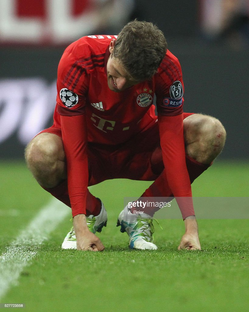 Thomas Mueller of Bayern Muenchen reacts after his team's loss of the Champions League semi final second leg match between FC Bayern Muenchen and Club Atletico de Madrid at Allianz Arena on May 3, 2016 in Munich, Germany.