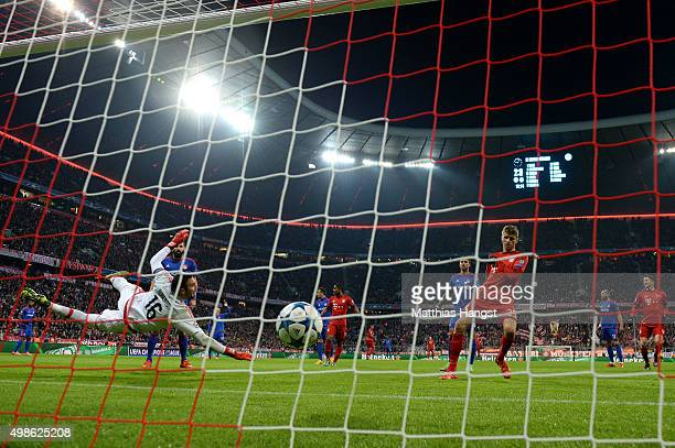 Thomas Mueller of Bayern Muenchen scores Bayern's third goal during the UEFA Champions League group F match between FC Bayern Munchen and Olympiacos...