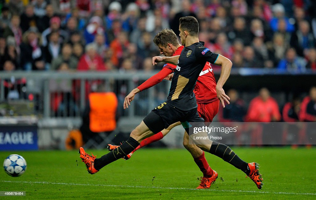 Thomas Mueller of Bayern Muenchen scores his side's fifth goal during the UEFA Champions League Group F match between FC Bayern Muenchen and Arsenal FC at the Allianz Arena on November 4, 2015 in Munich, Germany.