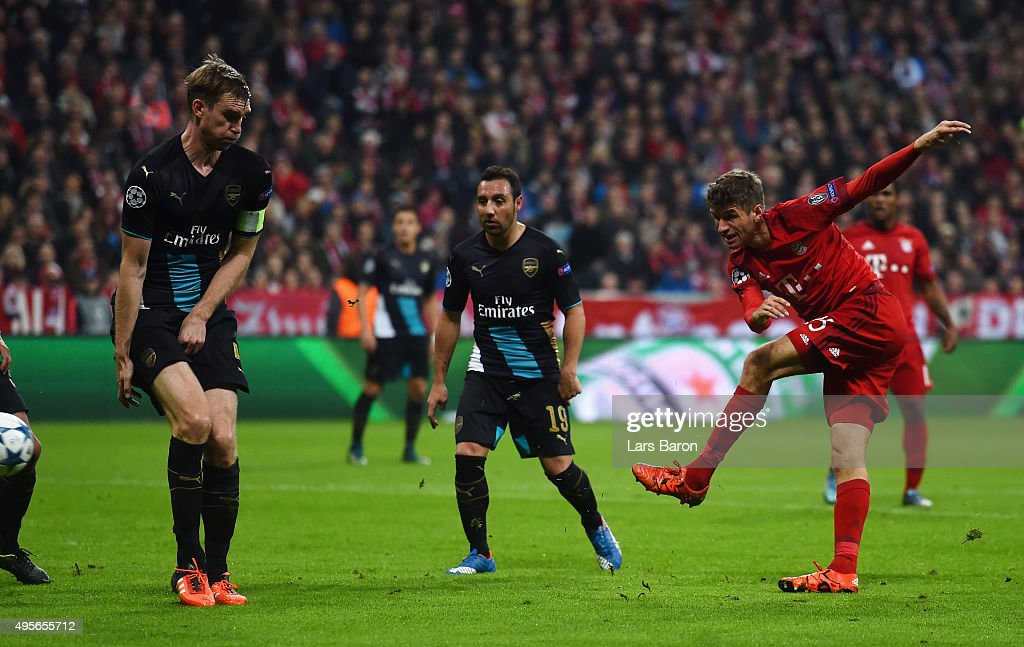 Thomas Mueller of Bayern Muenchen scores his side's second goal during the UEFA Champions League Group F match between FC Bayern Muenchen and Arsenal FC at the Allianz Arena on November 4, 2015 in Munich, Germany.