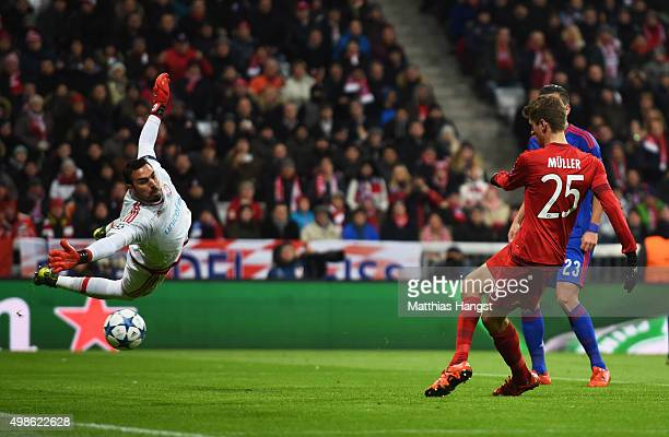 Thomas Mueller of Bayern Muenchen scores his teams third goal during the UEFA Champions League group F match between FC Bayern Munchen and Olympiacos...