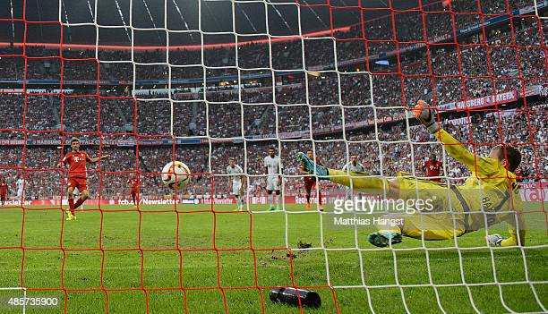 Thomas Mueller of Bayern Muenchen scores the 2nd goal by penalty during the Bundesliga match between FC Bayern Muenchen and Bayer Leverkusen at...