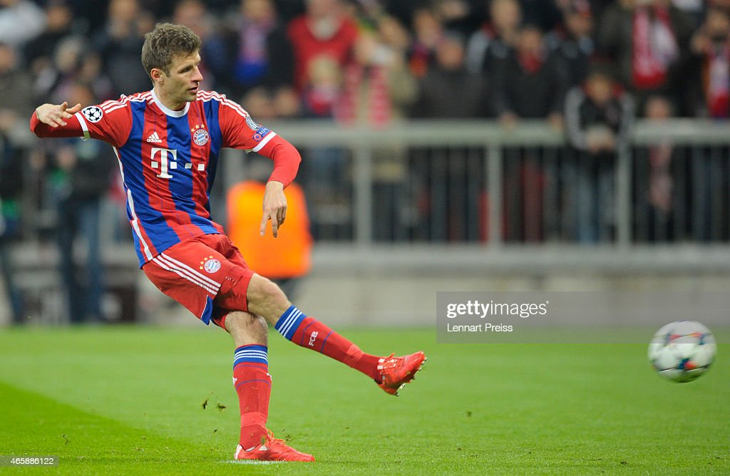 Thomas Mueller of Bayern Muenchen scores the opening goal with a penalty during the UEFA Champions League Round of 16 second leg match between FC Bayern Muenchen and FC Shakhtar Donetsk at Allianz Arena on March 11, 2015 in Munich, Germany.