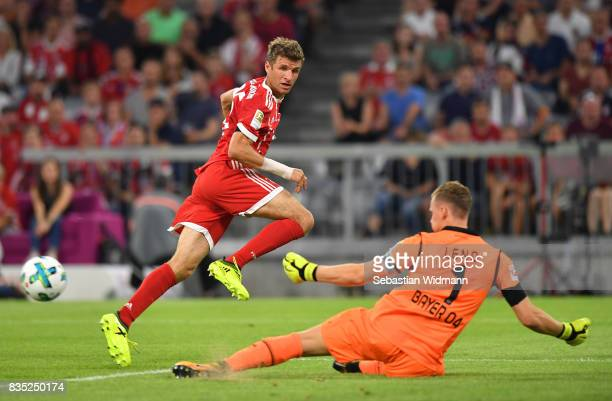 Thomas Mueller of Bayern Muenchen sees a shot saved by Bernd Leno of Bayer Leverkusen during the Bundesliga match between FC Bayern Muenchen and...
