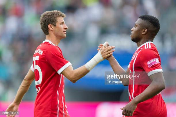 Thomas Mueller of Bayern Muenchen shakes hands with Franck Evina of Bayern Muenchen during the Telekom Cup 2017 Final between SV Werder Bremen and FC...
