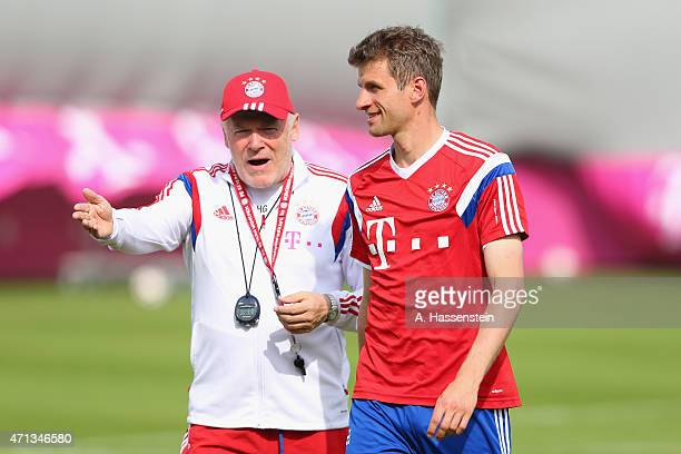 Thomas Mueller of Bayern Muenchen smiles with assistent coach Hermann Gerland during a training session at Bayern Muenchen's trainings ground...