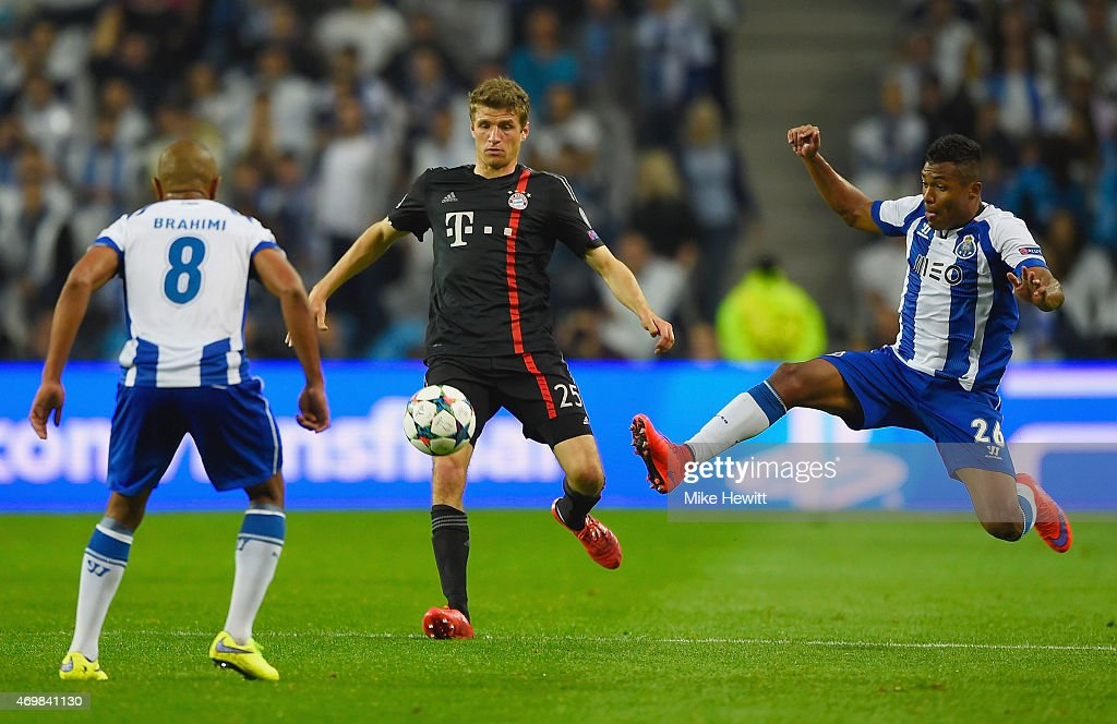 Thomas Mueller of Bayern Muenchen takes on Yacine Brahimi and Alex Sandro of FC Porto during the UEFA Champions League Quarter Final first leg match...