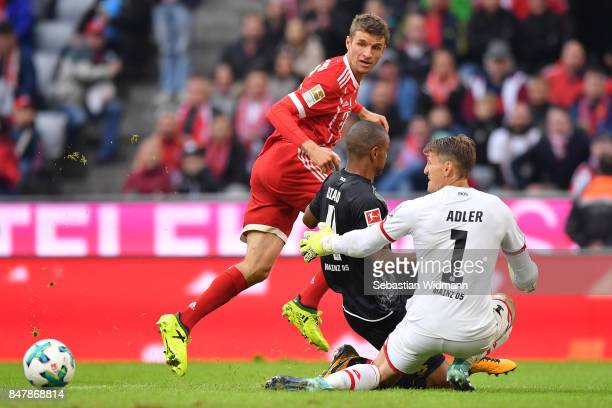 Thomas Mueller of Bayern Muenchen with Abdou Diallo of Mainz and Rene Adler of Mainz during the Bundesliga match between FC Bayern Muenchen and 1 FSV...