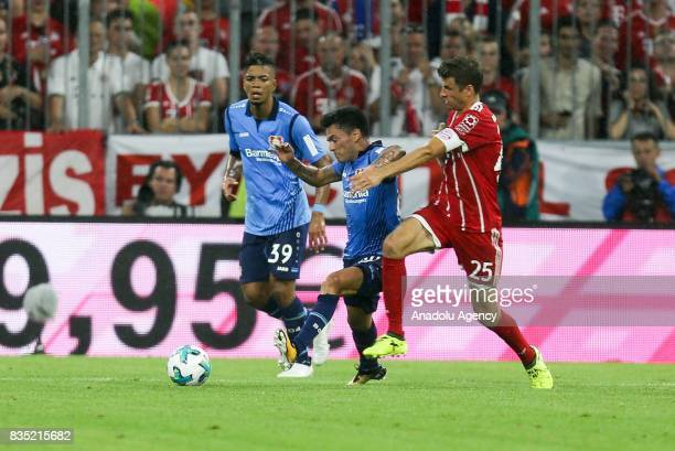 Thomas Mueller of Bayern Munich and Charles Aranguiz of Bayer 04 Leverkusen vie for the ball during the German First division Bundesliga soccer match...