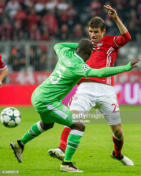 Thomas Mueller of Bayern Munich is challenged by Jetro Willems of Eindhoven during the UEFA Champions League group D match between Bayern Munich and...