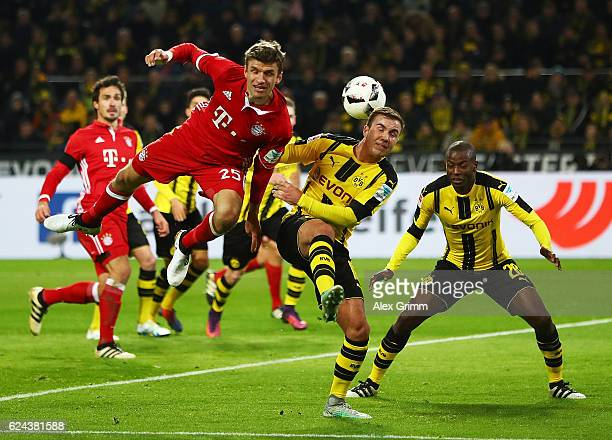 Thomas Mueller of Bayern Munich is challenged by Mario Goetze of Borussia Dortmund during the Bundesliga match between Borussia Dortmund and Bayern...