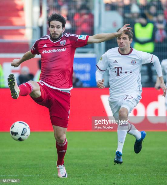 Thomas Mueller of Bayern Munich is challenged by Romain Bregerie of Ingolstadt during the Bundesliga match between FC Ingolstadt 04 and Bayern...