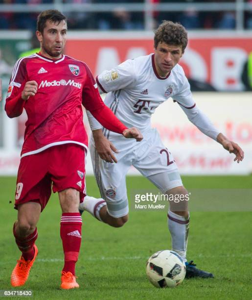 Thomas Mueller of Bayern Munich is challenged by Thomas Suttner of Ingolstadt during the Bundesliga match between FC Ingolstadt 04 and Bayern...