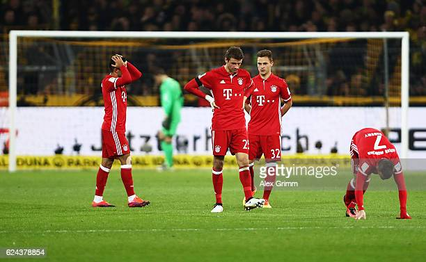 Thomas Mueller of Bayern Munich is dejected with team mates at half time during the Bundesliga match between Borussia Dortmund and Bayern Muenchen at...