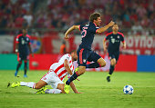 Thomas Mueller of Bayern Munich is tripped by Pajtim Kasami of Olympiakos during the UEFA Champions League Group F match between Olympiacos FC and FC...