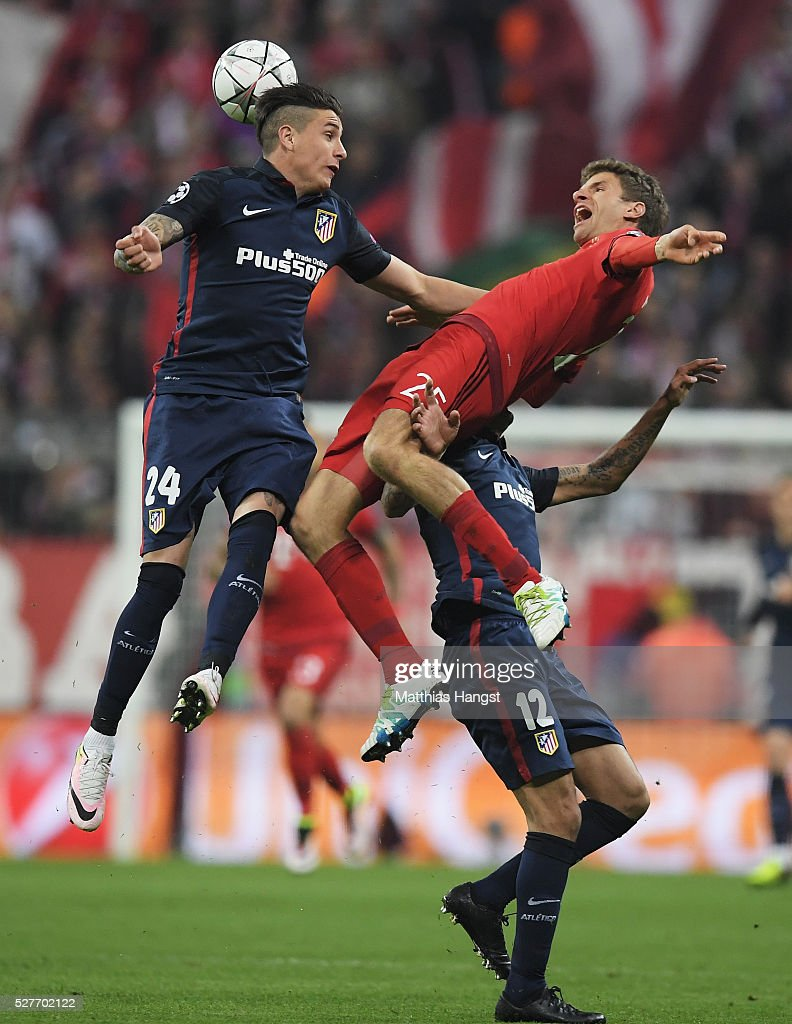 <a gi-track='captionPersonalityLinkClicked' href=/galleries/search?phrase=Thomas+Mueller&family=editorial&specificpeople=5842906 ng-click='$event.stopPropagation()'>Thomas Mueller</a> of Bayern Munich jumps with Jose Gimenez (24) and <a gi-track='captionPersonalityLinkClicked' href=/galleries/search?phrase=Augusto+Fernandez&family=editorial&specificpeople=684736 ng-click='$event.stopPropagation()'>Augusto Fernandez</a> of Atletico Madrid (12) during UEFA Champions League semi final second leg match between FC Bayern Muenchen and Club Atletico de Madrid at Allianz Arena on May 3, 2016 in Munich, Germany.