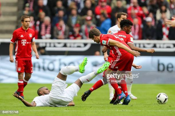Thomas Mueller of Bayern Munich Kingsley Coman of Bayern Munich and Anthony Modeste of Cologne battle for the ball during the Bundesliga match...