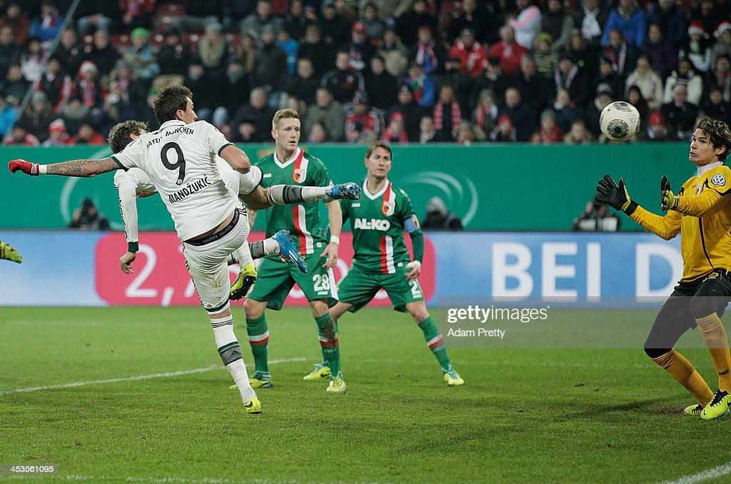 Thomas Mueller of Bayern scores a goal during the FC Augsburg v Bayern Muenchen DFB Cup match at SGL Arena on December 4, 2013 in Augsburg, Germany.