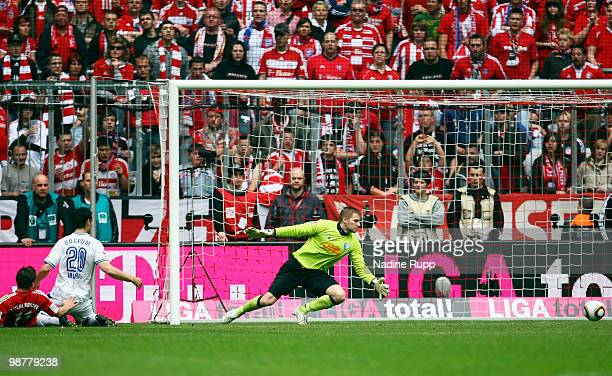 Thomas Mueller of Bayern scores his team's first goal against goalkeeper Philipp Heerwagen of Bochum during the Bundesliga match between FC Bayern...