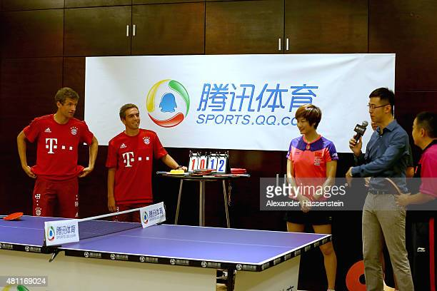 Thomas Mueller of FC Bayern Muenchen and his team mate Philipp Lahm plays a table tennis match broadcasted live on TV at Inter Continental Beijing...