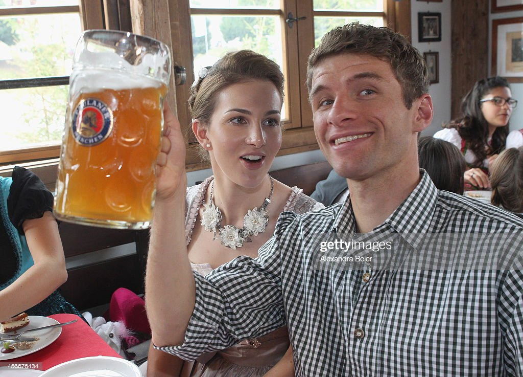 Thomas Mueller of FC Bayern Muenchen and his wife Lisa attend the Oktoberfest 2014 beer festival at Kaefers Wiesenschaenke at Theresienwiese on...