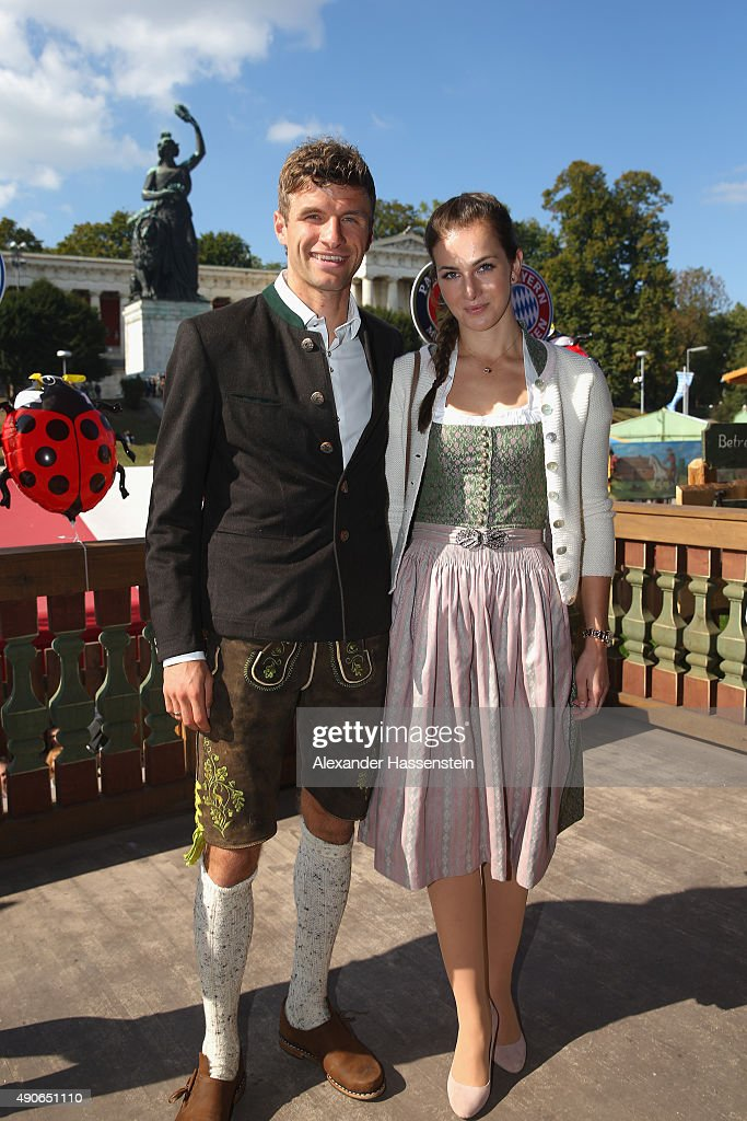 Thomas Mueller of FC Bayern Muenchen attends with his wife Lisa Mueller the Oktoberfest 2015 Beerfestival at Kaefer Wiesenschaenke at Theresienwiese on September 30, 2015 in Munich, Germany.