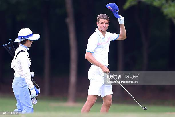 Thomas Mueller of FC Bayern Muenchen celebrates at the Audi quattro Cup 2015 at Sheshan Golf Club during day 4 of the FC Bayern Audi China Summer...