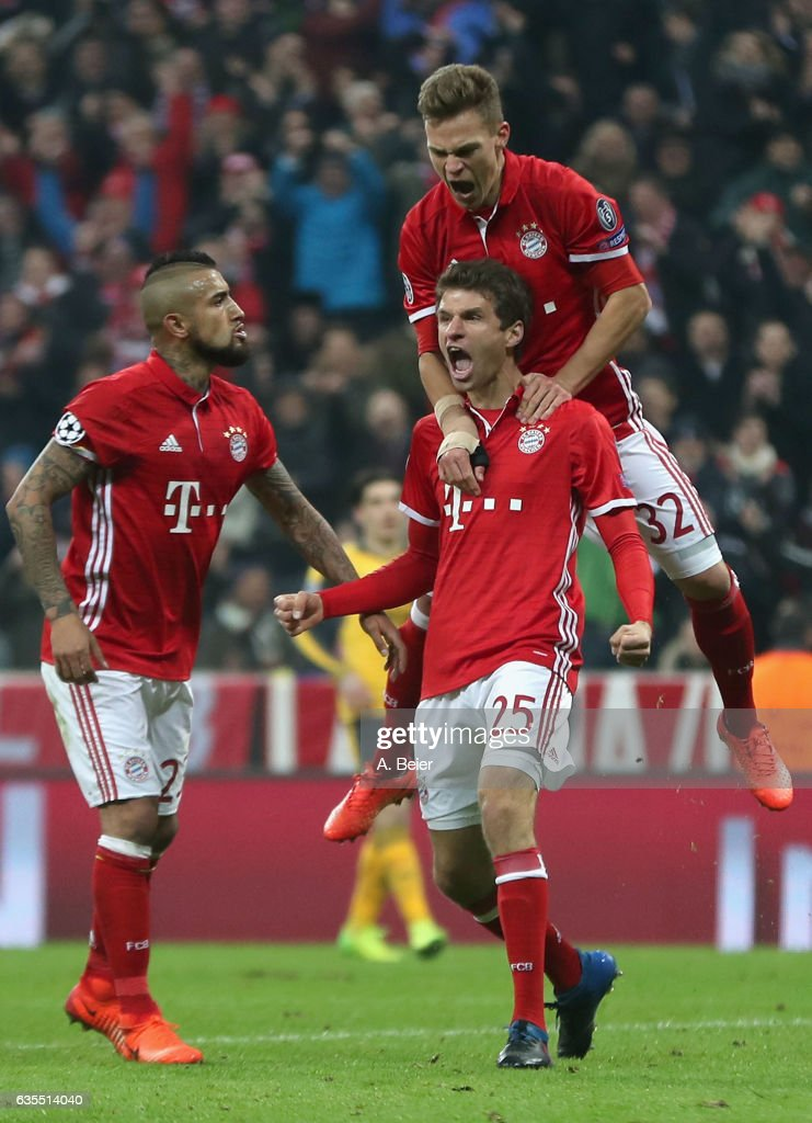 Thomas Mueller (bottom R) of FC Bayern Muenchen celebrates his goal together with teammates Arturo Vidal (L) and Joshua Kimmich during the UEFA Champions League Round of 16 first leg match between FC Bayern Muenchen and Arsenal FC at Allianz Arena on February 15, 2017 in Munich, Germany.