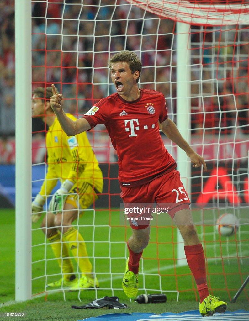 <a gi-track='captionPersonalityLinkClicked' href=/galleries/search?phrase=Thomas+Mueller&family=editorial&specificpeople=5842906 ng-click='$event.stopPropagation()'>Thomas Mueller</a> (R) of FC Bayern Muenchen celebrates scoring his team's third goal during the Bundesliga match between FC Bayern Muenchen and Hamburger SV at Allianz Arena on August 14, 2015 in Munich, Germany.