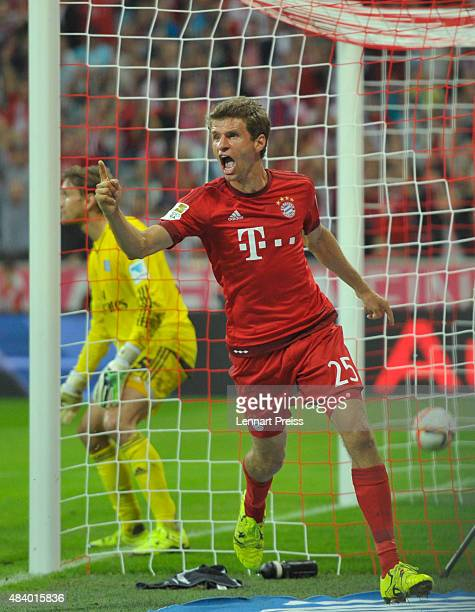 Thomas Mueller of FC Bayern Muenchen celebrates scoring his team's third goal during the Bundesliga match between FC Bayern Muenchen and Hamburger SV...