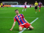 Thomas Mueller of FC Bayern Muenchen celebrates scoring the second goal during the DFB Pokal between FC Bayern Muenchen and Dortmund at...