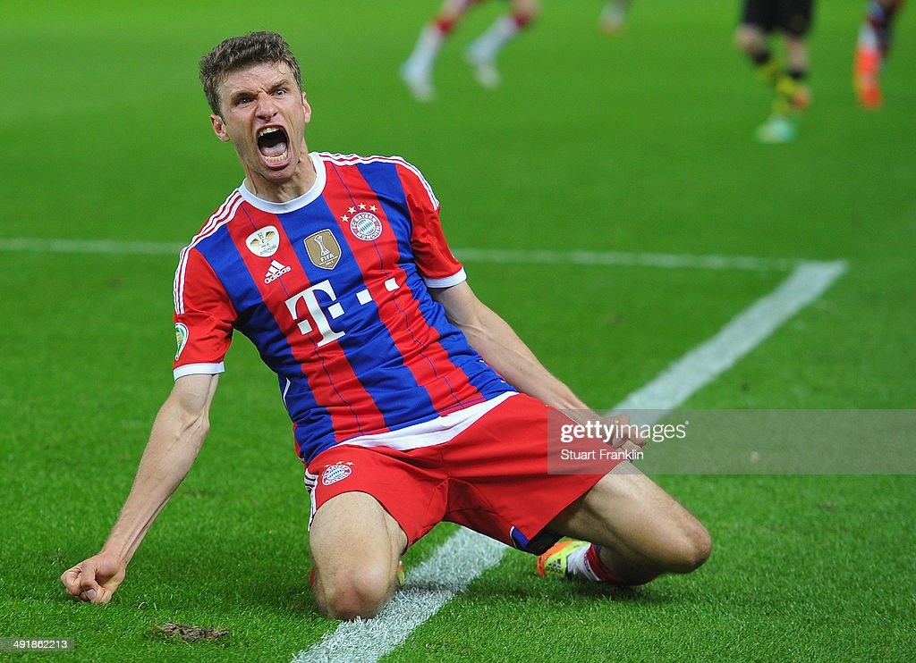 <a gi-track='captionPersonalityLinkClicked' href=/galleries/search?phrase=Thomas+Mueller&family=editorial&specificpeople=5842906 ng-click='$event.stopPropagation()'>Thomas Mueller</a> of FC Bayern Muenchen celebrates scoring the second goal during the DFB Pokal between FC Bayern Muenchen and Dortmund at Olympiastadion on May 17, 2014 in Berlin, Germany.