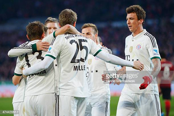 Thomas Mueller of FC Bayern Muenchen celebrates with teammates after scoring his team's first goal during the Bundesliga match between Hannover 96...