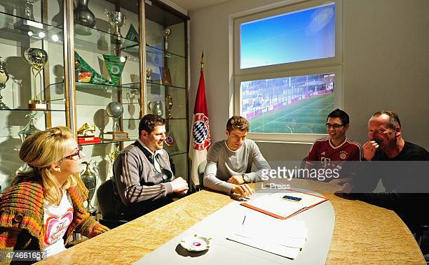 Thomas Mueller of FC Bayern Muenchen chats with fans during a Meet Greet with fans on February 24 2014 in Munich Germany
