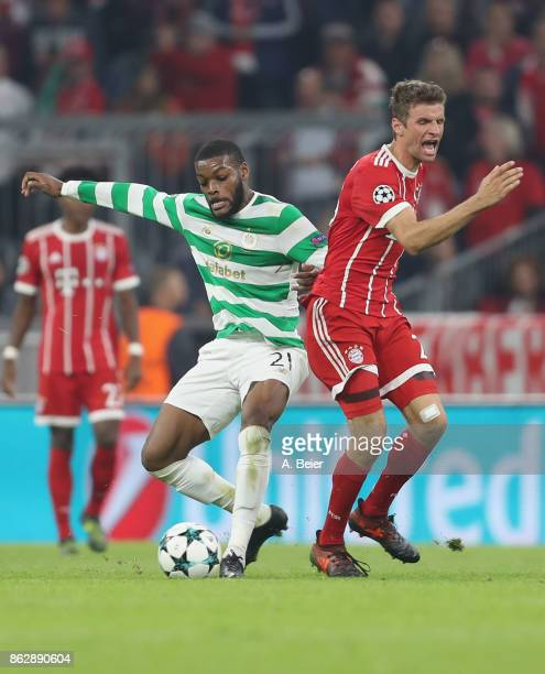 Thomas Mueller of FC Bayern Muenchen fights for the ball with Olivier Ntcham of Celtic FC during the UEFA Champions League group B match between...