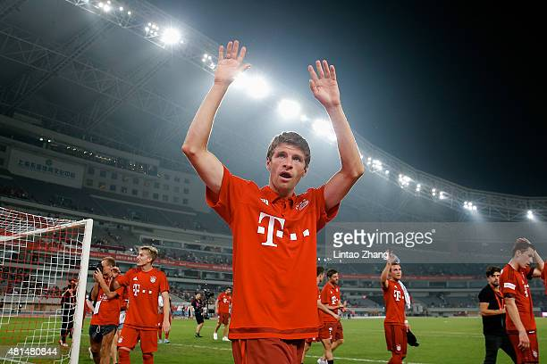 Thomas Mueller of FC Bayern Muenchen gestures to fans after winning the international friendly match between FC Bayern Muenchen and Inter Milan of...
