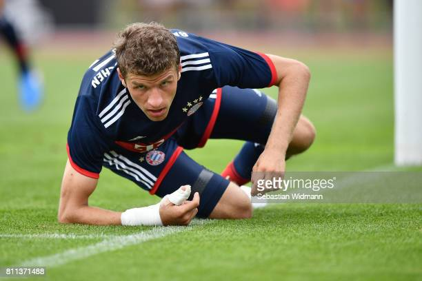 Thomas Mueller of FC Bayern Muenchen leans on his arm during the preseason friendly match between FSV ErlangenBruck and Bayern Muenchen at Adi...