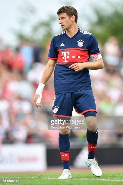 Thomas Mueller of FC Bayern Muenchen looks over his shoulder during the preseason friendly match between FSV ErlangenBruck and Bayern Muenchen at Adi...