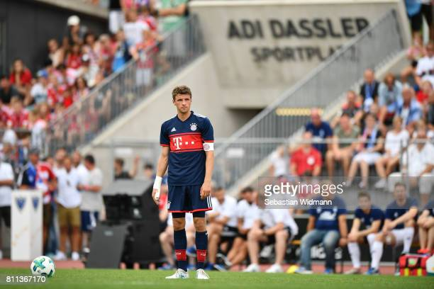 Thomas Mueller of FC Bayern Muenchen prepares for a free kick during the preseason friendly match between FSV ErlangenBruck and Bayern Muenchen at...