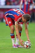 Thomas Mueller of FC Bayern Muenchen prepares the ball for a penalty kick during the Bundesliga match between FC Bayern Muenchen and SV Werder Bremen...