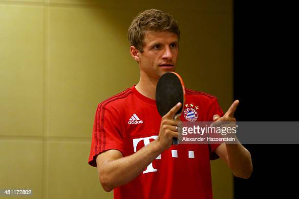 Thomas Mueller of FC Bayern Muenchen smiles during a table tennis match with his team mate Philipp Lahm broadcasted live on TV at Inter Continental...