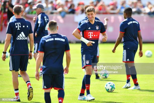 Thomas Mueller of FC Bayern Muenchen smiles during a training session at Saebener Strasse training ground on July 1 2017 in Munich Germany